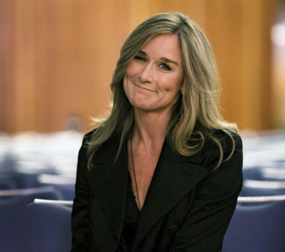 Screenshot of Angela Ahrendts sitting in a conference room.