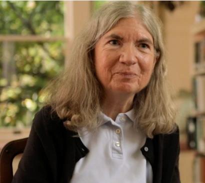 Screenshot of Carol Shaw smiling at the camera.