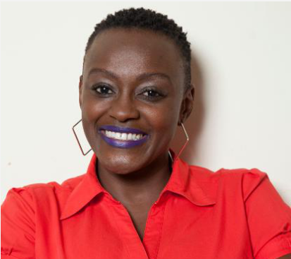 Portrait of Charity Wanjiku smiling at the camera.