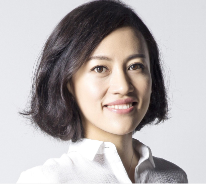 Studio portrait of Jean Liu smiling at the camera.