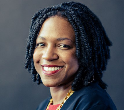 Portrait of Stacy Brown-Philpot smiling at the camera.