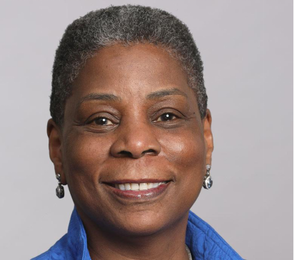 Portrait of Ursula Burns smiling at the camera.